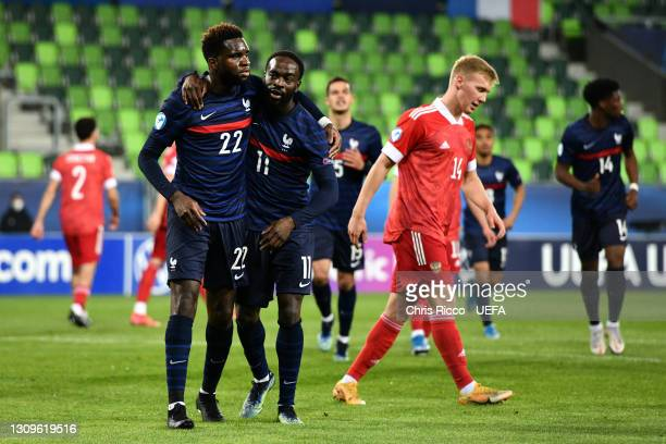 Odsonne Edouard of France celebrates with team mate Jonathan Ikone after scoring their side's first goal from the penalty spot during the 2021 UEFA...
