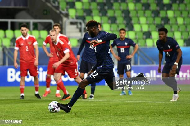 Odsonne Edouard of France scores their side's first goal from the penalty spot during the 2021 UEFA European Under-21 Championship Group C match...