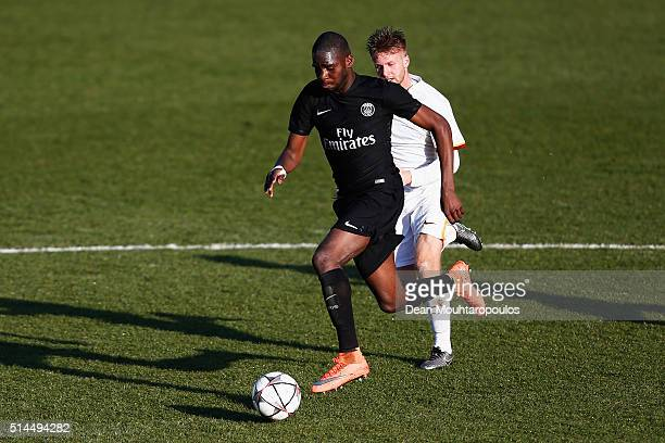 Odsonne Edouard of PSG gets past the tackle from Christian D'Urso during the UEFA Youth League Quarterfinal match between Paris Saint Germain and AS...