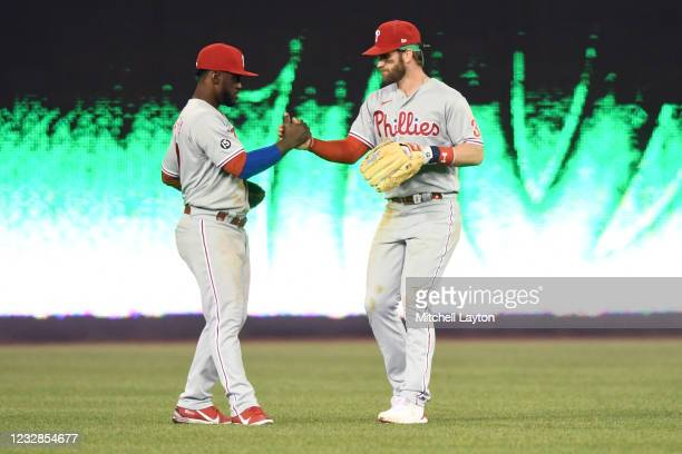 Odubel Herrera and Bryce Harper of the Philadelphia Phillies celebrate a win after a baseball game against the Washington Nationals at Nationals Park...