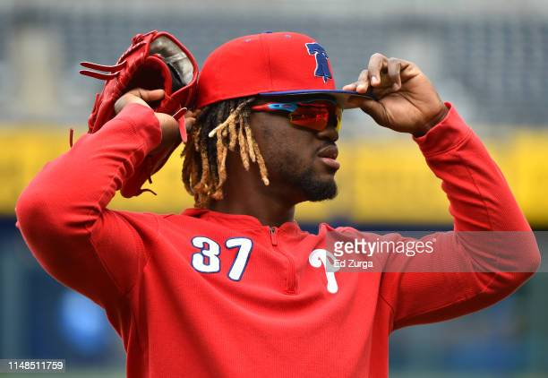 Odubel Herrera of the Philadelphia Phillies adjusts his cap as he prepares for batting practice prior to a game against the Kansas City Royals at...