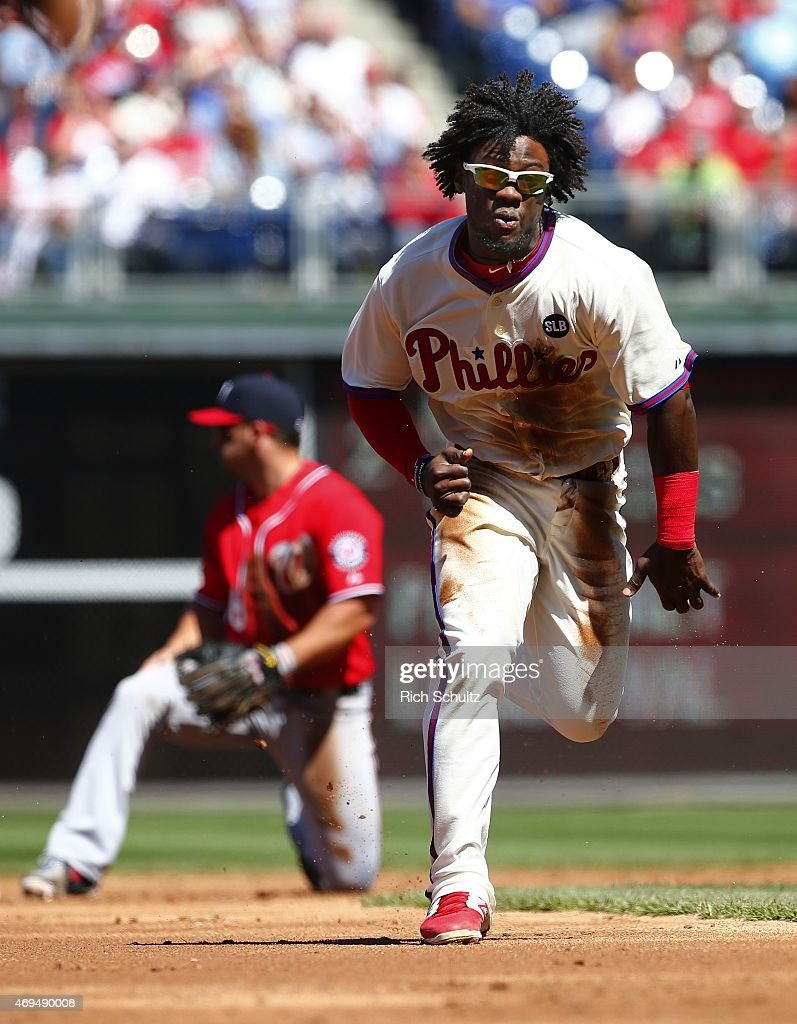 Odubel Herrera #37 of the Philadelphia Phillies advances to third base on an error after stealing second base against the Washington Nationals during the second inning of a game at Citizens Bank Park on April 12, 2015 in Philadelphia, Pennsylvania.