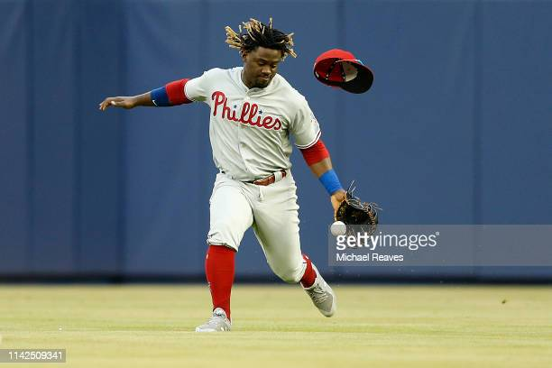 Odubel Herrera of the Philadelphia Phillies attempts to catch a bloop hit against the Miami Marlins in the fourth inning at Marlins Park on April 13...