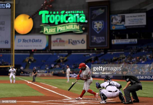 Odubel Herrera of the Philadelphia Phillies breaks his bat in the first inning during a game against the Tampa Bay Rays at Tropicana Field on April...