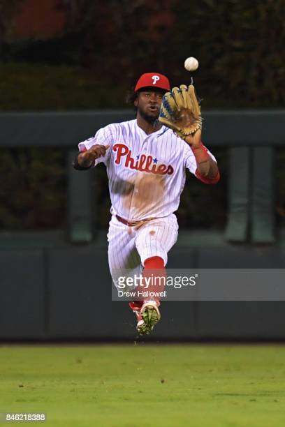 Odubel Herrera of the Philadelphia Phillies catches a fly ball in the third inning against the Miami Marlins at Citizens Bank Park on September 12...