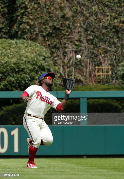 Odubel Herrera of the Philadelphia Phillies catches a fly ball in the first inning during a game against the Atlanta Braves at Citizens Bank Park on...