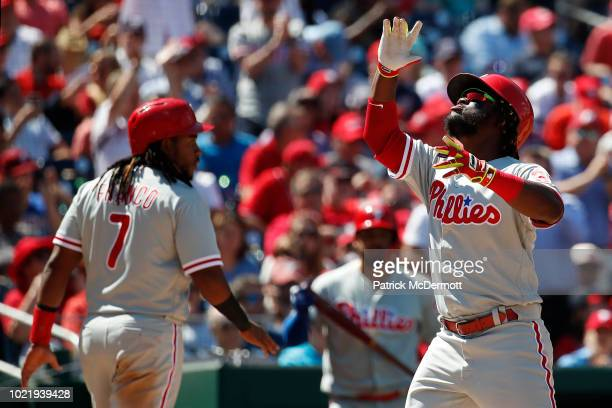 Odubel Herrera of the Philadelphia Phillies celebrates after hitting a tworun home run in the seventh inning against the Washington Nationals at...