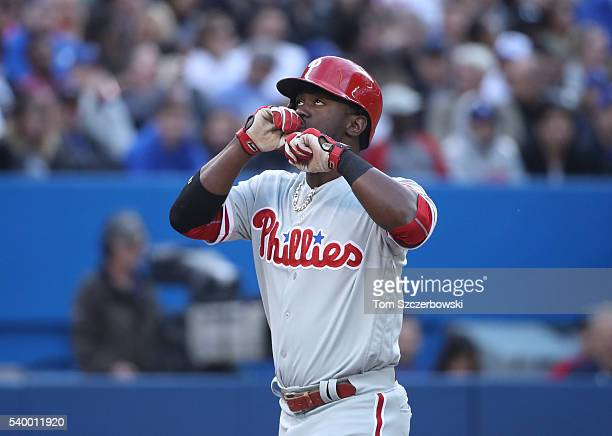 Odubel Herrera of the Philadelphia Phillies celebrates after hitting a solo home run in the third inning during MLB game action against the Toronto...