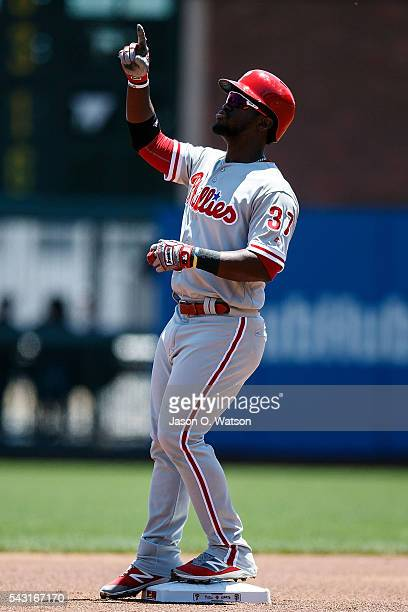 Odubel Herrera of the Philadelphia Phillies celebrates after hitting a double against the San Francisco Giants during the first inning at ATT Park on...