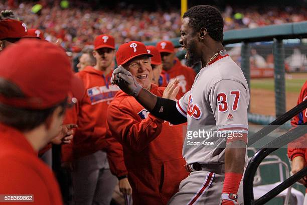 Odubel Herrera of the Philadelphia Phillies celebrates as he enters the dugout after hitting a solo home run during the fifth inning against the St...