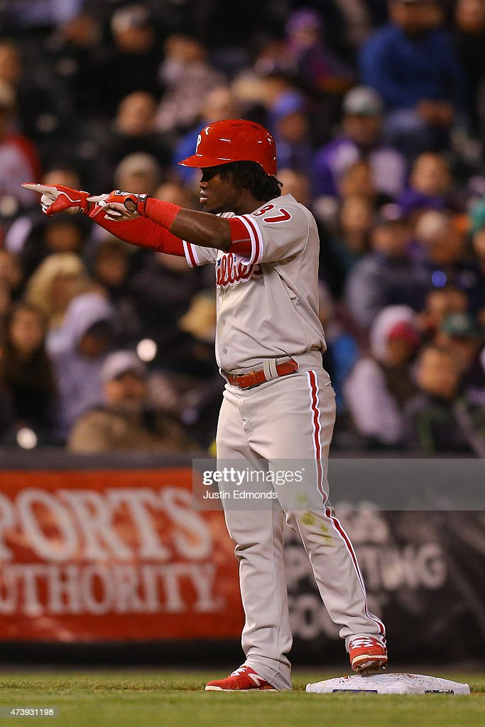 Odubel Herrera #37 of the Philadelphia Phillies celebrates by pointing to the dugout after his two RBI triple during the sixth inning against the Colorado Rockies at Coors Field on May 18, 2015 in Denver, Colorado.