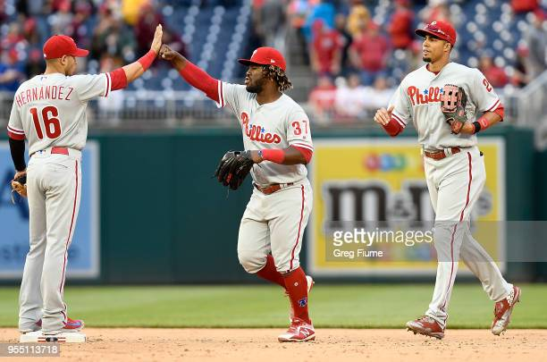 Odubel Herrera of the Philadelphia Phillies celebrates with Cesar Hernandez after a 31 victory against the Washington Nationals at Nationals Park on...