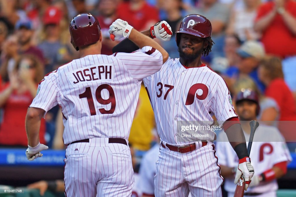 Odubel Herrera #37 of the Philadelphia Phillies congratulates teammate Tommy Joseph #19 on a home run against the San Diego Padres in the fourth inning at Citizens Bank Park on July 7, 2017 in Philadelphia, Pennsylvania.
