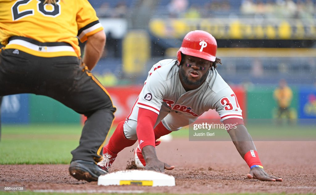 Odubel Herrera #37 of the Philadelphia Phillies dives back to first base after a pick off attempt in the seventh inning during the game against the Pittsburgh Pirates at PNC Park on May 21, 2017 in Pittsburgh, Pennsylvania.