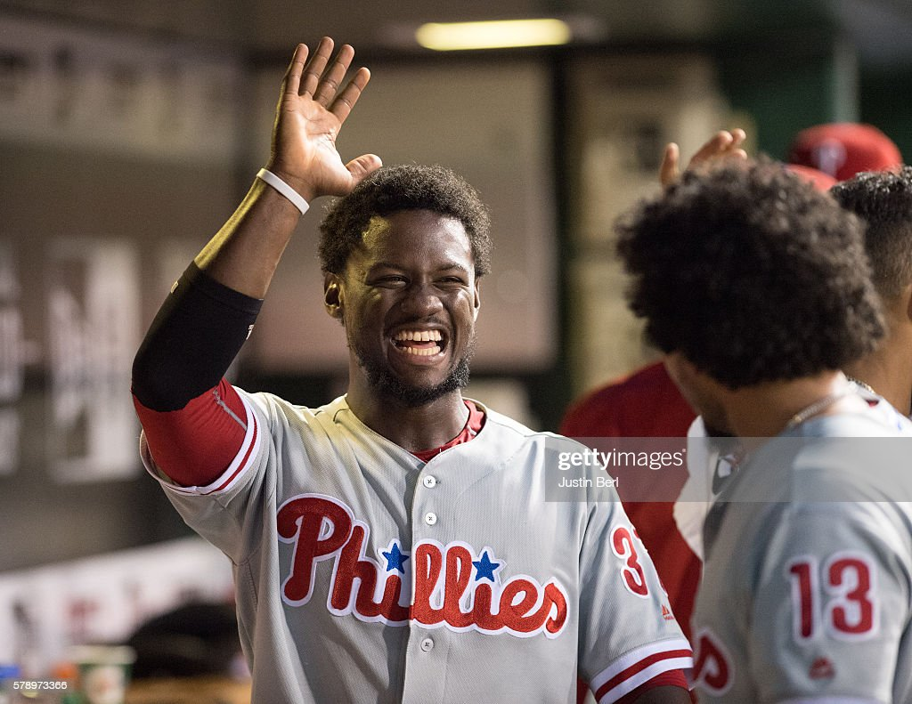 Odubel Herrera #37 of the Philadelphia Phillies gets a high five from Freddy Galvis #13 after coming around to score in the seventh inning during the game against the Pittsburgh Pirates at PNC Park on July 22, 2016 in Pittsburgh, Pennsylvania.