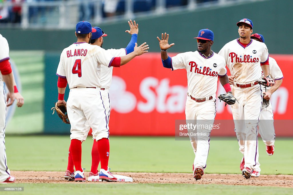Odubel Herrera #37 of the Philadelphia Phillies high fives teammates after the game against the Chicago Cubs at Citizens Bank Park on September 13, 2015 in Philadelphia, Pennsylvania. The Phillies won 7-4.