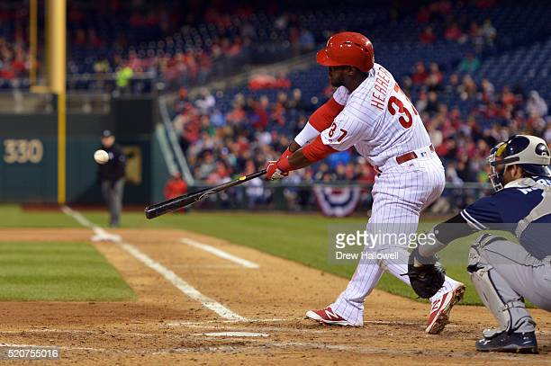 Odubel Herrera of the Philadelphia Phillies hits a one run triple the sixth inning against the San Diego Padres at Citizens Bank Park on April 12...