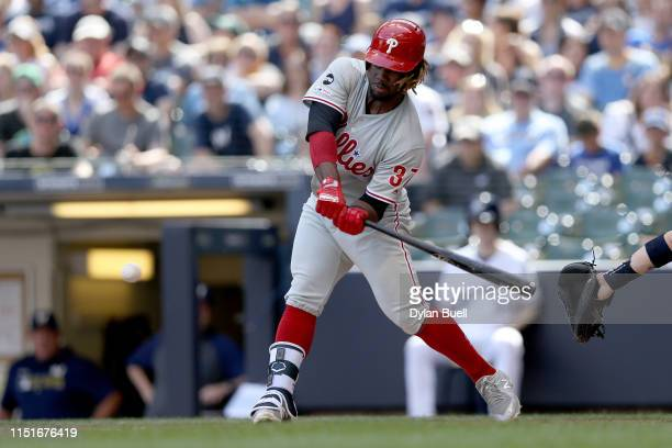 Odubel Herrera of the Philadelphia Phillies hits a single in the second inning against the Milwaukee Brewers at Miller Park on May 25 2019 in...