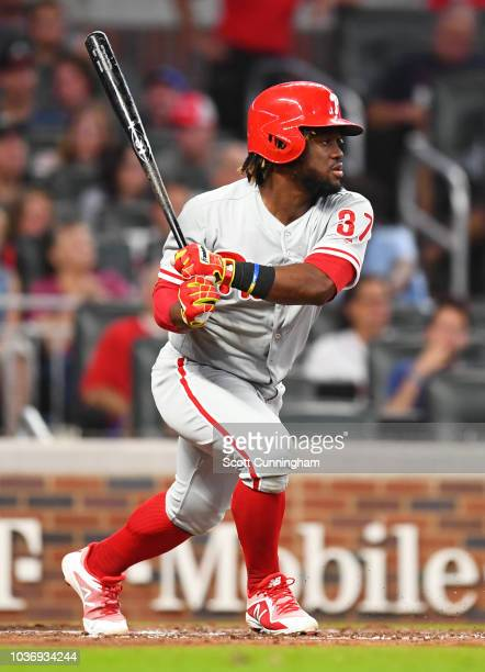 Odubel Herrera of the Philadelphia Phillies hits a third inning single to score a run against the Atlanta Braves at SunTrust Park on September 20...