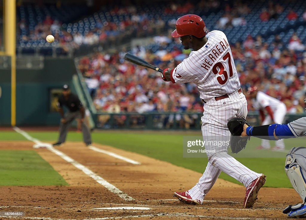 Odubel Herrera #37 of the Philadelphia Phillies hits an RBI double in the third inning against the Los Angeles Dodgers at Citizens Bank Park on August 4, 2015 in Philadelphia, Pennsylvania.