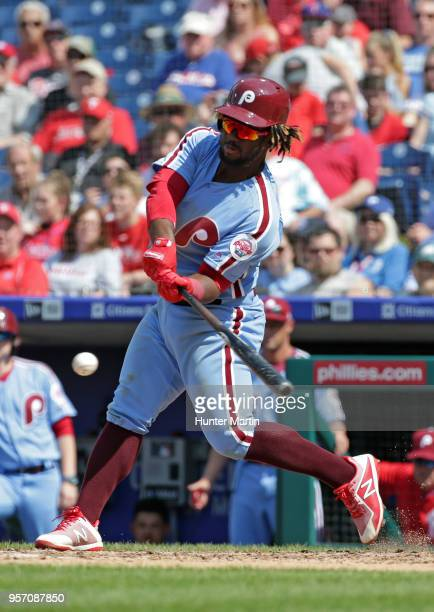 Odubel Herrera of the Philadelphia Phillies hits an RBI single in the seventh inning during a game against the San Francisco Giants at Citizens Bank...