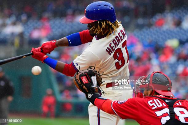 Odubel Herrera of the Philadelphia Phillies hits as Kurt Suzuki of the Washington Nationals catches during the first inning at Citizens Bank Park on...
