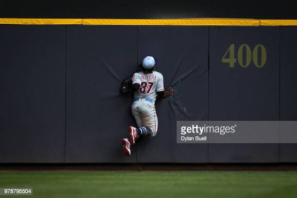 Odubel Herrera of the Philadelphia Phillies hits the outfield wall after catching a fly ball in the ninth inning against the Milwaukee Brewers at...