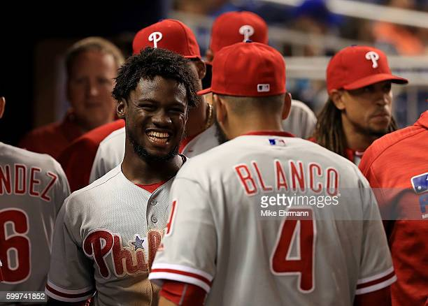 Odubel Herrera of the Philadelphia Phillies is congratulated after scoring during a game against the Miami Marlins at Marlins Park on September 6...