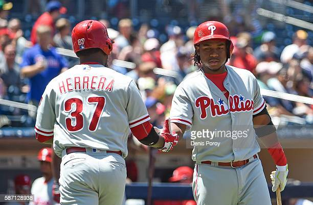 Odubel Herrera of the Philadelphia Phillies is congratulated by Maikel Franco after hitting a solo home run during the first inning of a baseball...