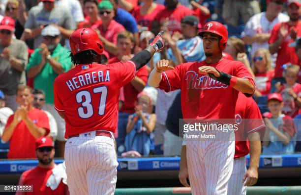 Odubel Herrera of the Philadelphia Phillies is congratulated by Aaron Altherr after hitting a threerun home run in the third inning during a game...