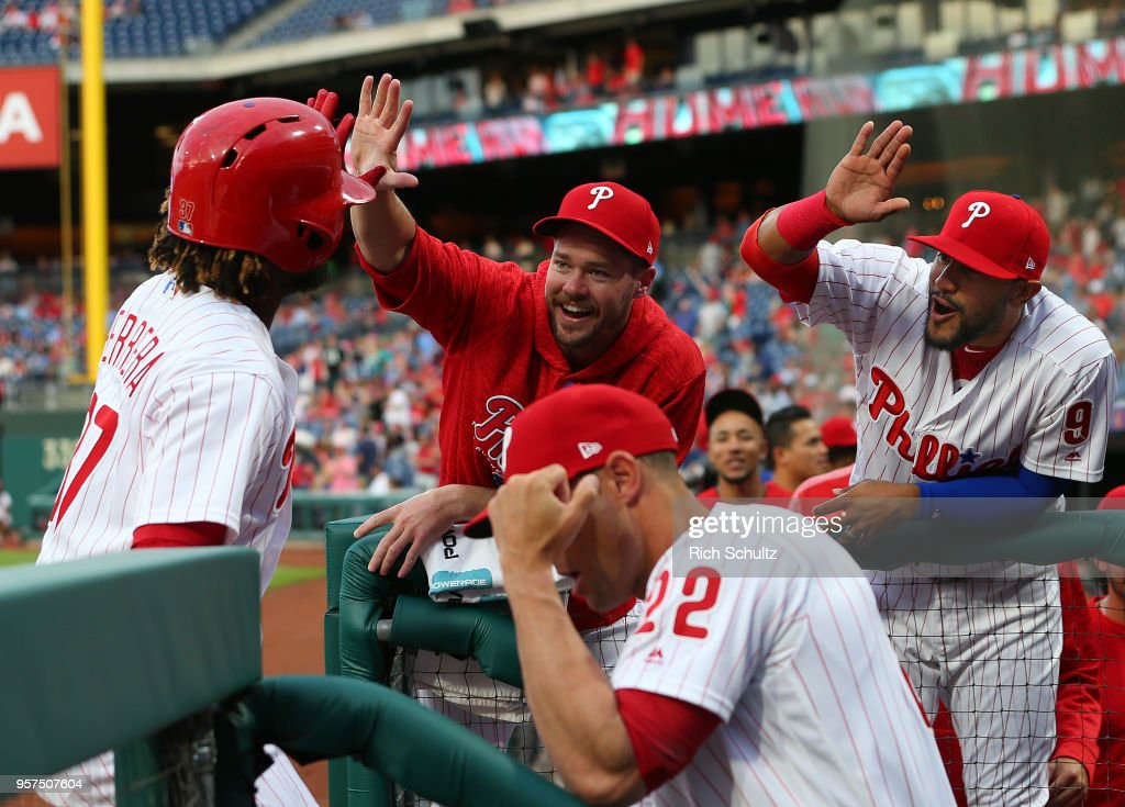 Odubel Herrera #37 of the Philadelphia Phillies is congratulated by Andrew Knapp #15 and Jesmuel Valentin #9 after hitting a home run during the first inning of a game against the New York Mets at Citizens Bank Park on May 11, 2018 in Philadelphia, Pennsylvania.