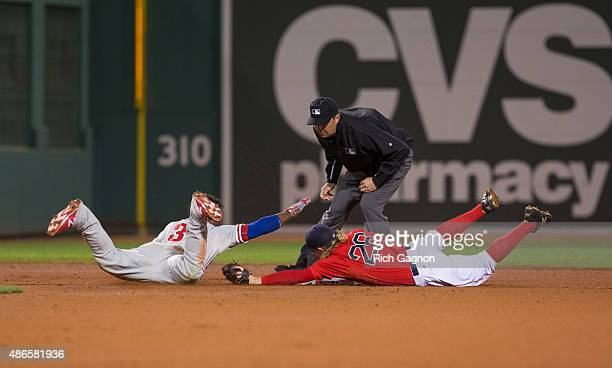 Odubel Herrera of the Philadelphia Phillies is tagged out at second base by Brock Holt of the Boston Red Sox after he slid past second base as second...