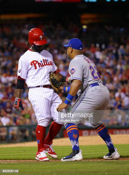 Odubel Herrera of the Philadelphia Phillies is tagged out by Dominic Smith of the New York Mets in the fourth inning during a game at Citizens Bank...