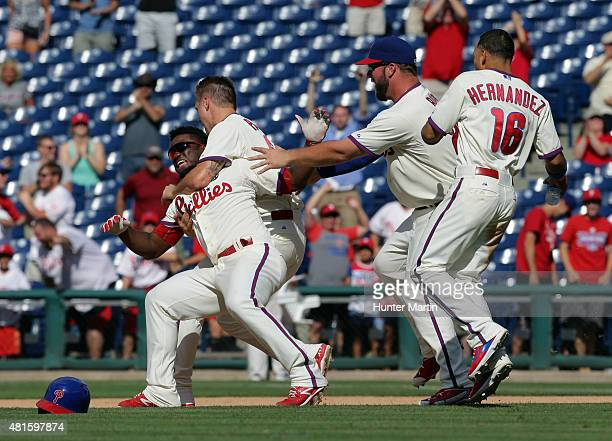 Odubel Herrera of the Philadelphia Phillies is taken down to the ground by Jonathan Papelbon after singling in the game winning run in the 10th...