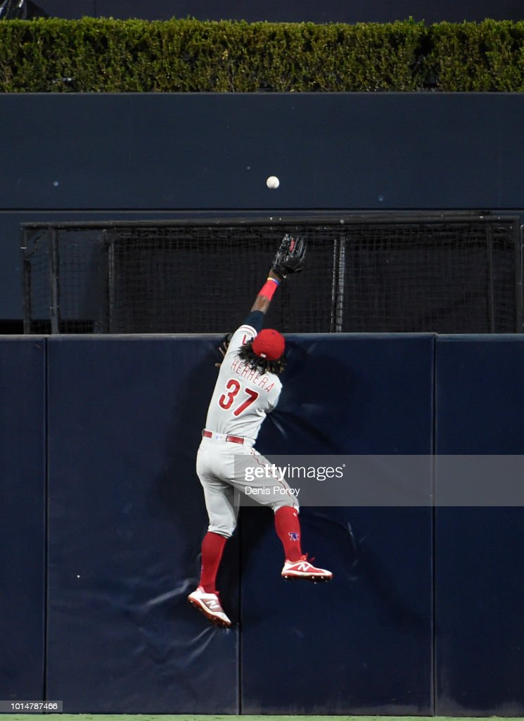 Odubel Herrera #37 of the Philadelphia Phillies jumps but can't make the catch on a home run hit by Austin Hedges #18 of the San Diego Padres during the fourth inning of a baseball game at PETCO Park on August 10, 2018 in San Diego, California.