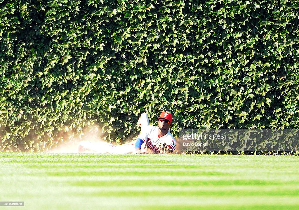 Odubel Herrera #37 of the Philadelphia Phillies makes a catch on Kris Bryant #17 of the Chicago Cubs to save a no hitter during the ninth inning on July 25, 2015 at Wrigley Field in Chicago, Illinois. Cole Hamels #35 of the Philadelphia Phillies pitched a no hitter and The Phillies won 5-0.