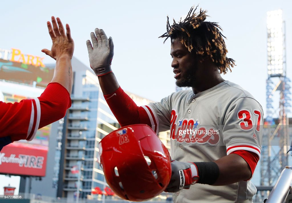 Odubel Herrera #37 of the Philadelphia Phillies reacts after hitting a solo homer in the first inning against the Atlanta Braves with Cesar Hernandez #16 at SunTrust Park on April 16, 2018 in Atlanta, Georgia.
