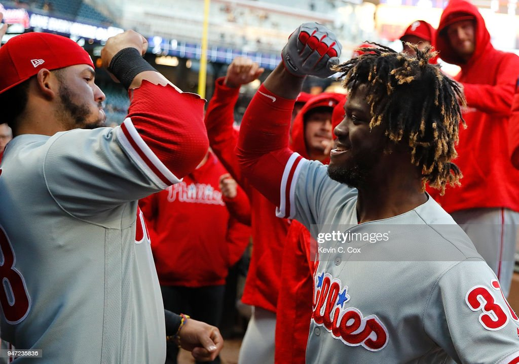 Odubel Herrera #37 of the Philadelphia Phillies reacts after hitting a solo homer in the first inning against the Atlanta Braves with Jorge Alfaro #38 at SunTrust Park on April 16, 2018 in Atlanta, Georgia.