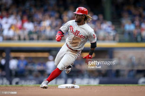 Odubel Herrera of the Philadelphia Phillies rounds second base in the fourth inning against the Milwaukee Brewers at Miller Park on May 25 2019 in...