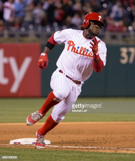 Odubel Herrera of the Philadelphia Phillies rounds third and scores a run in the bottom of the first inning against the Washington Nationals at...