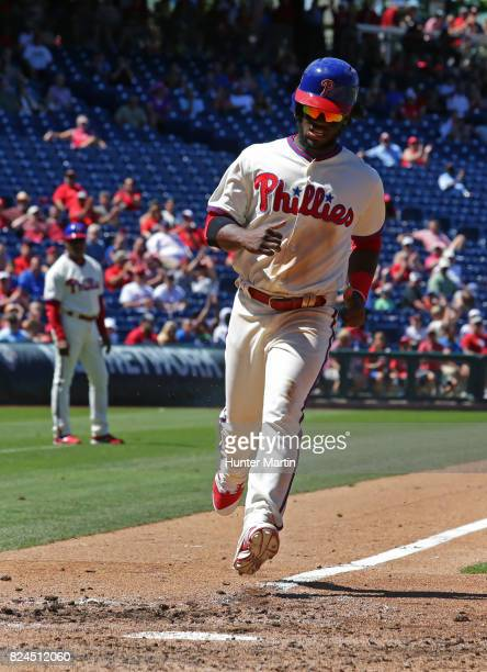 Odubel Herrera of the Philadelphia Phillies scores a run on a passed ball in the fourth inning during a game against the Atlanta Braves at Citizens...