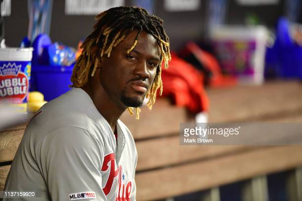 Odubel Herrera of the Philadelphia Phillies sits in the dugout during the fourth inning against the Miami Marlins at Marlins Park on April 14 2019 in...