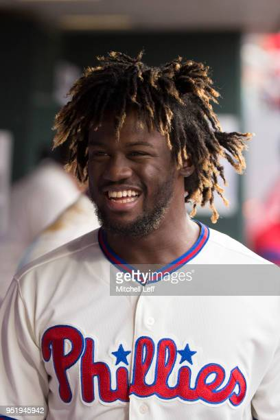 Odubel Herrera of the Philadelphia Phillies smiles in the dugout against the Pittsburgh Pirates at Citizens Bank Park on April 21 2018 in...