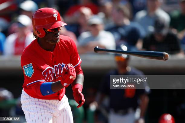 Odubel Herrera of the Philadelphia Phillies throws his bat after drawing a walk during the first inning of the Spring Training game against the...