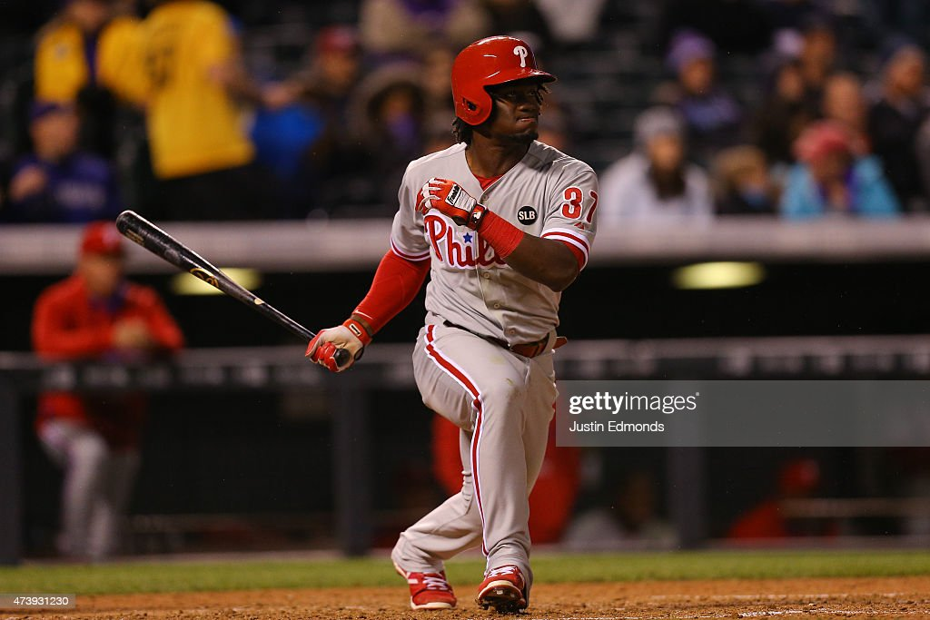 Odubel Herrera #37 of the Philadelphia Phillies watches his two RBI triple during the sixth inning against the Colorado Rockies at Coors Field on May 18, 2015 in Denver, Colorado.