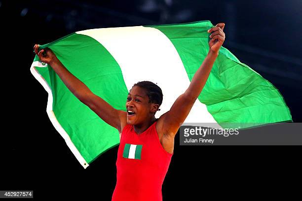 Odunayo Adekuoroye of Nigeria celebrates after winning the gold medal in the Women's FS 53kg Gold Medal match at the Scottish Exhibition and...