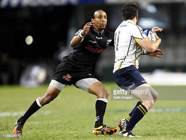 Odwa Ndungane of Sharks attempts to tackle Adam AshleyCooper of Brumbies during the Vodacom SupeRugbY match between the Sharks and Brumbies from Mr...