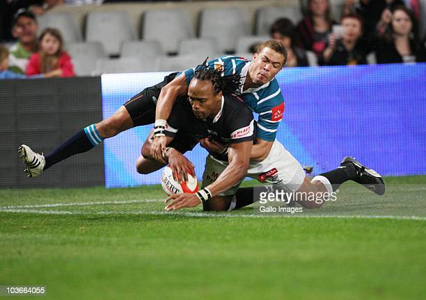 Odwa Ndunganeu scores during the Absa Currie Cup match between the Sharks and GWK Griquas at Absa Stadium on August 27, 2010 in Durban, South Africa.