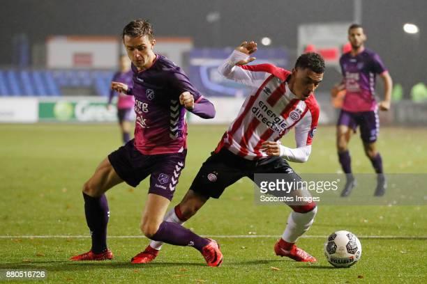 Odysseus Velanas of FC Utrecht U23 Donyell Malen of PSV U23 during the Dutch Jupiler League match between PSV U23 v Utrecht U23 at the De Herdgang on...