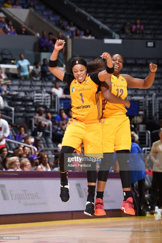 Odyssey Sims #1 and Chelsea Gray #12 of the Los Angeles Sparks react to a play against the New York Liberty on August 4, 2017 at the STAPLES Center in Los Angeles, California.